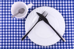 Empy Mug with spoon,  plate with a knife and fork Stock Photography
