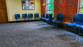 Empy office waiting room in vintage brick building royalty free stock image
