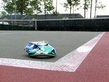 Empy Tennis Court With Beaten Soda Can. Beaten up soda can as a trash in empty tennis court Stock Photos