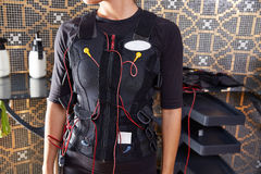 EMS electro stimulation suit woman Royalty Free Stock Image