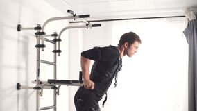 EMS. Fit man doing triceps dips on parallel bars. EMS. Fit man doing triceps dips on parallel bars stock footage