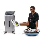 EMS fitness man doing L-Sit plank on bosu ball Royalty Free Stock Photos