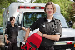 EMS with Oxygen. EMS professional with portable oxygen equipment royalty free stock photos