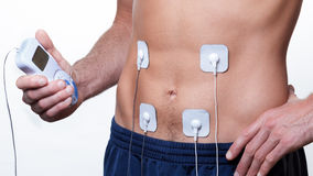 Ems que treina a estimulação elétrica do músculo Fotos de Stock Royalty Free