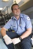 EMT Sitting In Ambulance医生 库存照片