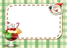 An emtpy christmas card with a smiling Santa and a glass of swee Stock Photo