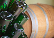 Emty bottles and barrel. Royalty Free Stock Photography