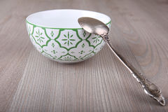 Emty decorated bowl and spoon Royalty Free Stock Photo