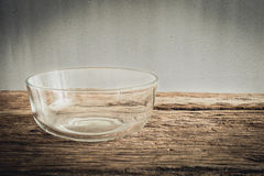 Emty glass bowl on wooden tabletop Stock Image