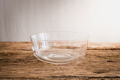 Emty glass bowl on wooden tabletop Stock Photo