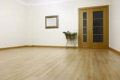Emty room. Empty room, door, mirror, floor paper, wall, ready to move Stock Photography