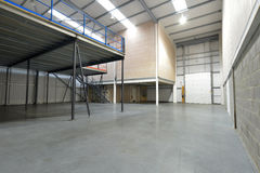 Emty warehouse. Interior view of emty warehouse and mezzanine floor royalty free stock photos
