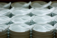Emty white ceramic bowls and spoons Stock Images