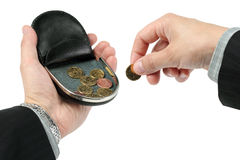 En ändringshandväska på en gömma i handflatan, rymmer ett mynt Fotografering för Bildbyråer