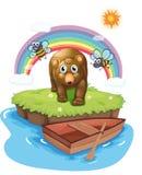 En ö med ett Big Bear och bin Arkivfoton