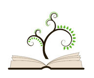 En öppen bok med det stiliserade trädet Arkivbild