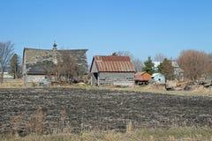 En Abandonded Minnesota lantgårdplats Arkivbild