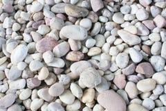 En abstrakt bakgrund med torra runda reeble stenar Arkivfoto