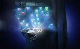 En affärsman med affärssymboler i en hologram Arkivbilder