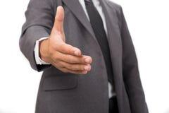 En affärsman med en öppen hand som är klar för att handshaking ska försegla a Royaltyfri Foto