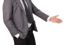 En affärsman med en öppen hand som är klar för att handshaking ska försegla a Fotografering för Bildbyråer