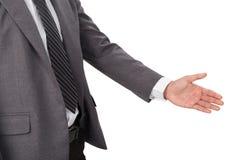 En affärsman med en öppen hand som är klar för att handshaking ska försegla a Royaltyfri Bild