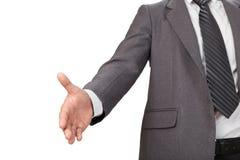 En affärsman med en öppen hand som är klar för att handshaking ska försegla a Royaltyfria Foton