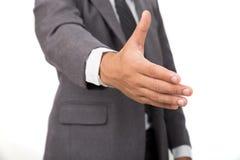 En affärsman med en öppen hand som är klar för att handshaking ska försegla a Royaltyfria Bilder