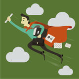 En affärsman som framåt flyger Arkivbild