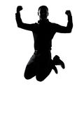En affärsman som hoppar den kraftiga silhouetten Arkivfoto