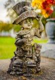 En allvarlig garnering eller en allvarlig staty arkivfoton