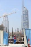 En arbetare på konstruktionsplats i Dubai Royaltyfri Bild