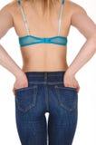 En arrière du femme dans des jeans Photo libre de droits