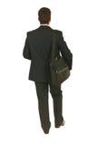 En arrière de l'homme d'affaires allant fonctionner Images stock