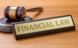 En auktionsklubba och en k?nd platta med den finansiella lagen f?r gravyr arkivfoton