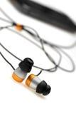 En auricular del oído con el jugador audio móvil Foto de archivo libre de regalías