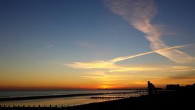 En av härliga solnedgångar för december` s arkivbilder