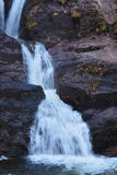 En av vattenfallen från den skotska Skotska högländerna Royaltyfri Bild