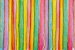En bakgrund av utskrivavna och drog färgglade band Arkivbild