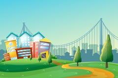 En bana som går till de färgrika byggnaderna i staden Arkivbild