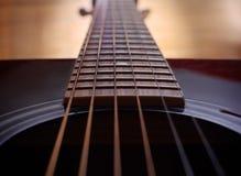En bas du cou de guitare Photographie stock libre de droits