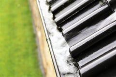En begreppsbild av en avrinning med regndroppar - regn Royaltyfri Fotografi