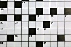 En begreppsbild av ett korsordpussel Arkivbilder