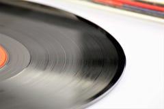 En begreppsbild av ett vinylrekord - lp, tappning Royaltyfri Bild