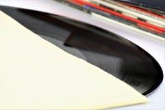 En begreppsbild av ett vinylrekord - lp, tappning Arkivfoto