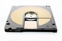 En begreppsbild av en mini- diskettCD Arkivfoton