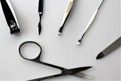 En begreppsbild av spikar manikyr, utrustning Arkivbilder