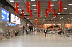 Hustlebrådska av den Bangkok flygplatsen Arkivfoton