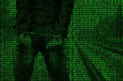 En bild av en binär kod från ljust - gräsplandiagram, till och med som bilden av en arresterad och handfängslad person Arkivbild