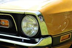 En bild av en klassiker oss bil, tappning, billykta Royaltyfri Foto